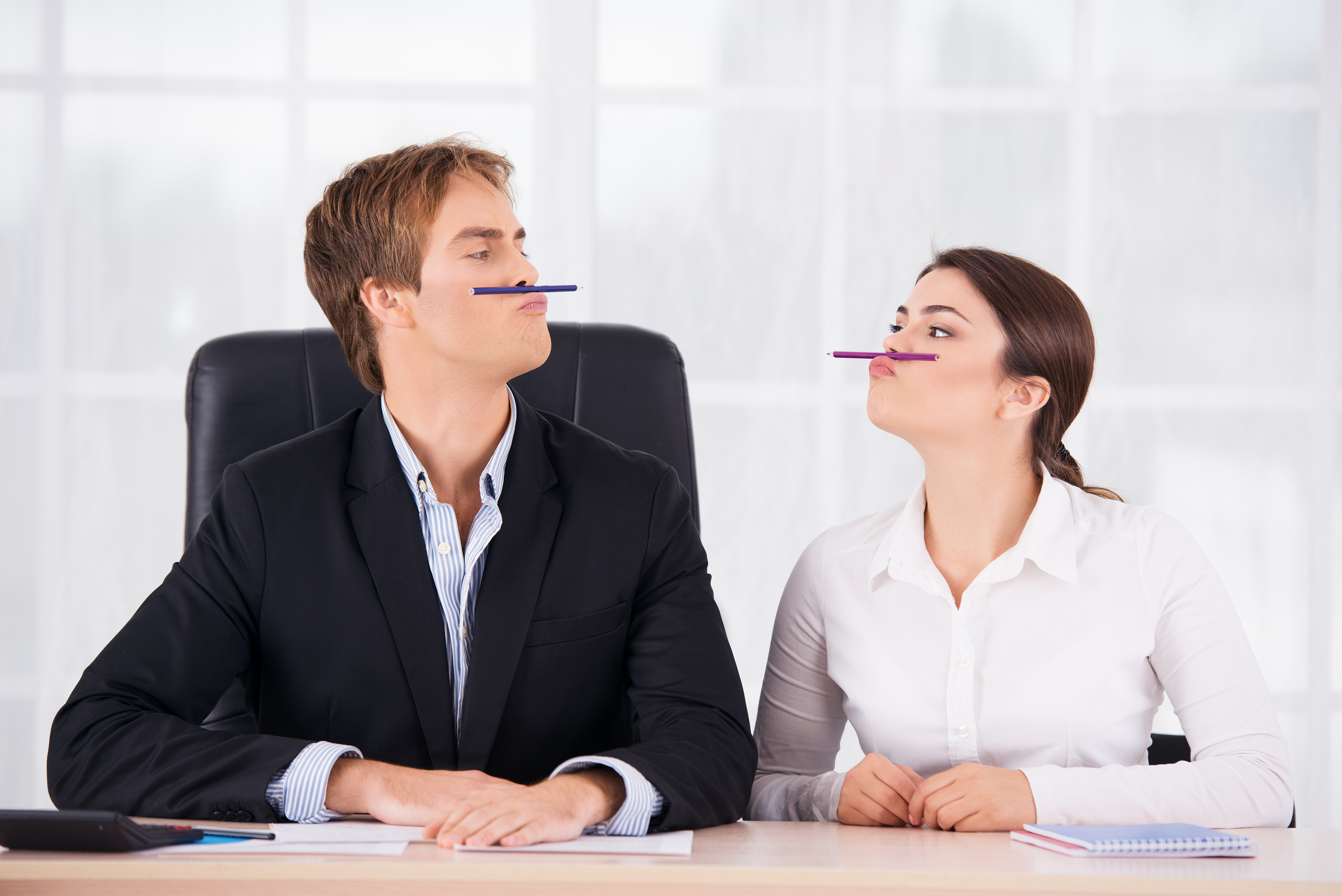 Business woman and man having fun in office
